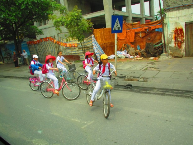 More school children. The red bandanna means that their parents are Communist Party members, and thus have special privileges.