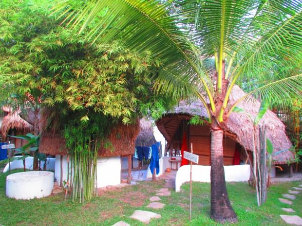 a mushroom hut with ensuite on left