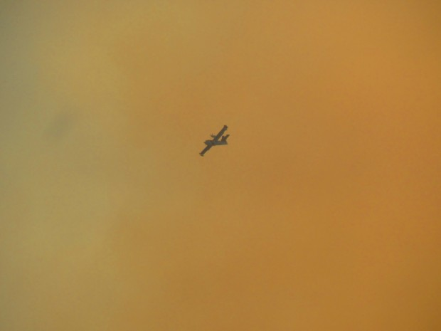 plane over the fire