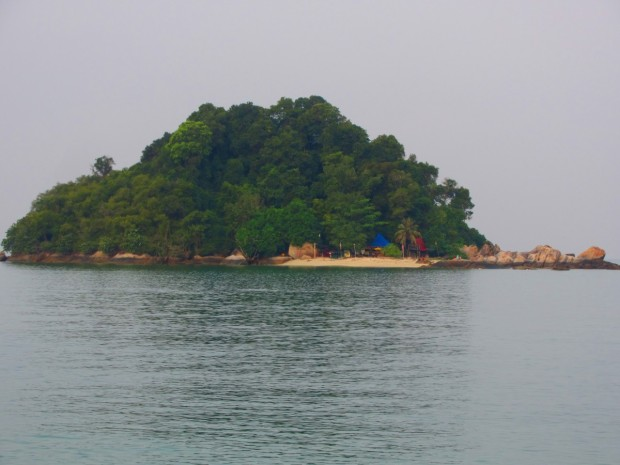 view of Giam Island seen from Nipah  Beach - where you can catch a boat to to snorkel