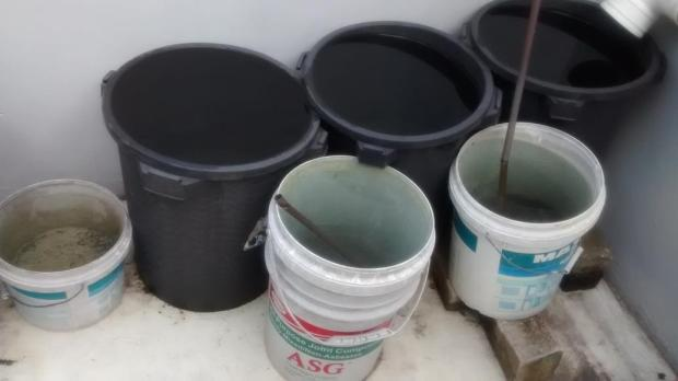 My water collection - this is enough to water the garden for four days.  There is copper in every container to keep mosquitoes away.