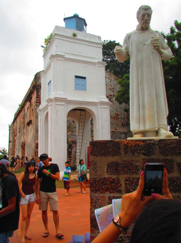 ruin of St. Paul's and a marble statue of St. Francis Xavier