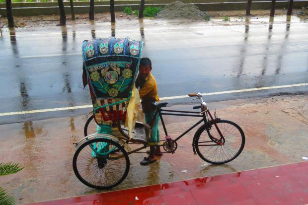 rickshaw in the rain - the orangey sheet is supposed to keep your body dry
