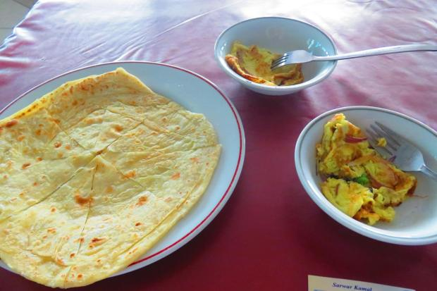 breakfast one morning - paratha, dhal  and  omelette