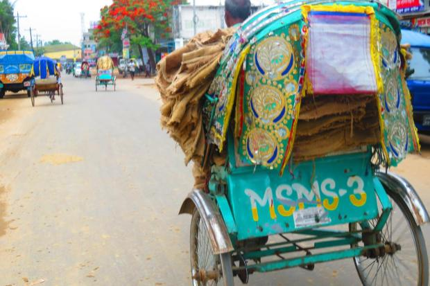 rickshaws are used to carry all sorts of things