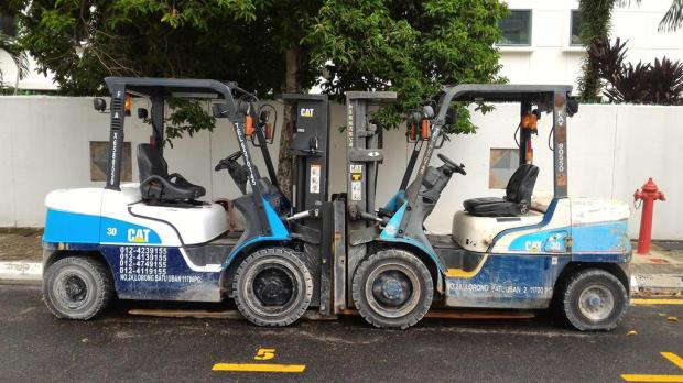 two forklifts, one parking space