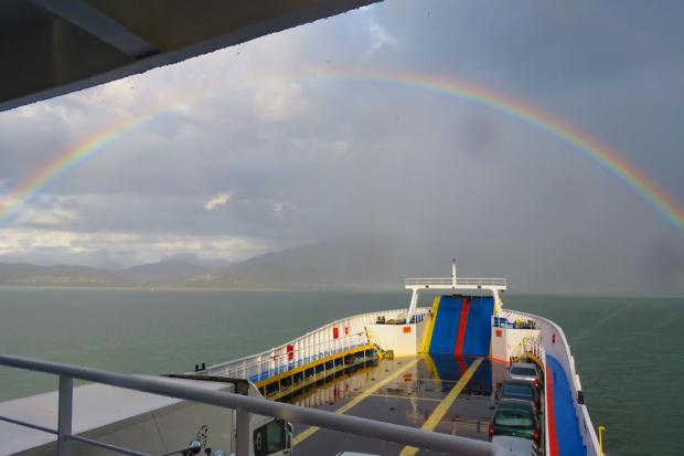 rainbow approaching the mainland
