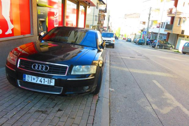 """cars park all over the """"footpaths"""" - often you must walk on the road"""